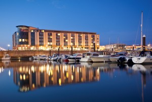Rad Blu Jersey Hotel exterior with marina